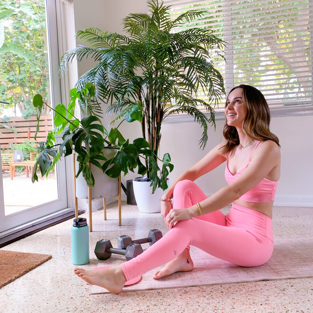 woman showing Workout-From-Home Essentials in pink