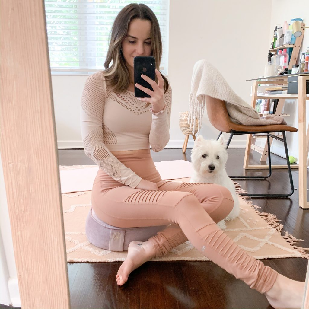 woman wearing her Workout-From-Home Essentials and her dog