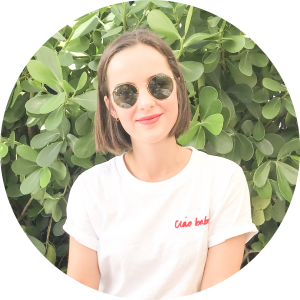 woman with short hair and wearing sunglasses for Grow Out Your Hair