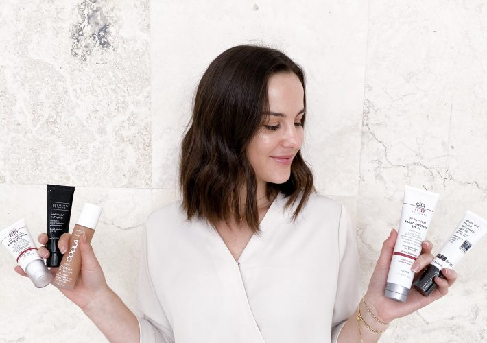 woman holding different facial sunscreen