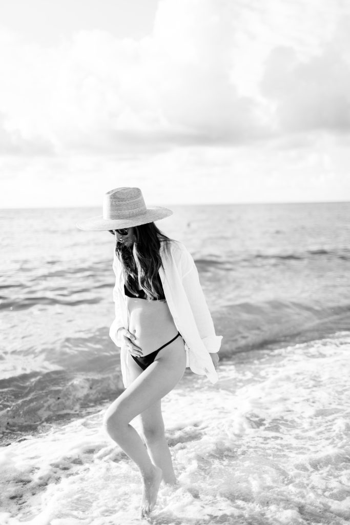 black and white photo of a Pregnant at the beach